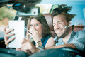 Young beautiful couple lovers using tablet in the car travel Royalty Free Stock Photography