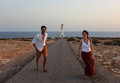 Young beautiful couple`s portrait with Cap de Barberia`s lighthouse on soft background, Formentera, Balearic Islands, Spain Royalty Free Stock Photo