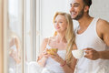Young Beautiful Couple Stand Near Big Window, Drink Morning Coffee Cup, Happy Smile Hispanic Man And Woman Royalty Free Stock Photo
