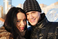 Young beautiful couple stand together and smile at sunny winter day Stock Images