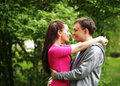 Young beautiful couple in a sweet cheek kiss Royalty Free Stock Photo