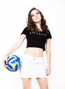 Young beautiful curly girl with professional make-up, holding a ball