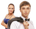 Young beautiful elegant couple men in suit and bow tie with women in blue dress Stock Photo