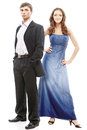 Young beautiful elegant couple men in suit with women in blue dress Royalty Free Stock Image