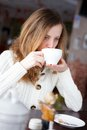Young beautiful elegant woman drinking coffee or tea tea time Stock Photo
