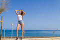 Young beautiful and expressive dark haired girl playful joyful teenage in jean shorts high heels practicing catwalk outdoors Royalty Free Stock Photos