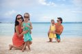 Young beautiful family with two kids on tropical vacation this image has attached release Royalty Free Stock Images