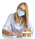 Young beautiful female doctor with recipe and mask over white Stock Photos