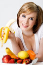 Young beautiful female eating a bananna Royalty Free Stock Photos