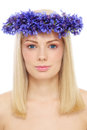 Young beautiful fresh blond girl crown blue flowers over white background Royalty Free Stock Photos