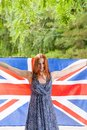 Young beautiful girl against green holds britain flag Royalty Free Stock Photography