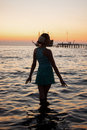 Young beautiful girl on the beach looking out to sea Royalty Free Stock Photo