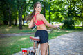 Young beautiful girl with bike outdoor Royalty Free Stock Photos
