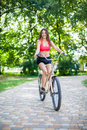 Young beautiful girl with bike outdoor Royalty Free Stock Image
