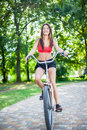 Young beautiful girl with bike outdoor Royalty Free Stock Photography