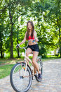 Young beautiful girl with bike outdoor Stock Images
