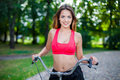 Young beautiful girl with bike outdoor Royalty Free Stock Images