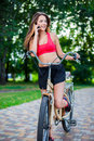 Young beautiful girl with bike outdoor Stock Photos