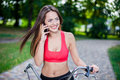 Young beautiful girl with bike outdoor Stock Photo