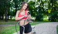Young beautiful girl with bike outdoor Royalty Free Stock Photo