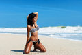 Young beautiful girl in a bikini on a beach Royalty Free Stock Image