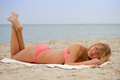 Young beautiful girl in bikini sunbathing on the beach freedom summertime concept Stock Images