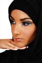 A young beautiful girl with a black headscarf and nice makeup with her hand under her skin looking away for in closeup over white Stock Photo
