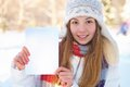 Young beautiful girl with blank banner. Winter. Royalty Free Stock Photography
