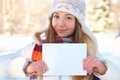 Young beautiful girl with blank banner. Winter. Stock Images