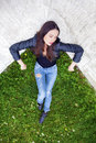 Young beautiful girl in blue jeans and a black leather jacket on Royalty Free Stock Photo
