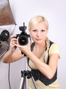 Young beautiful girl with the camera in studio Royalty Free Stock Photo