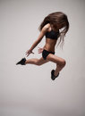 Young beautiful girl doing gymnastick jump studio gradient background Royalty Free Stock Photos