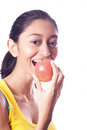 Young beautiful girl eating an apple Royalty Free Stock Photo