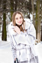 Young beautiful girl in fur smiling, and walking t Royalty Free Stock Images
