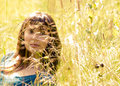 Young beautiful girl in a grass Royalty Free Stock Photography