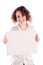 Young beautiful girl holds a empty white sign for you to fill in your message Stock Image