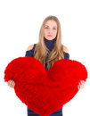 Young beautiful girl hugs a big soft heart Royalty Free Stock Photo