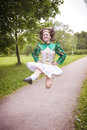 Young beautiful girl in irish dance dress jumping outdoor Royalty Free Stock Photo