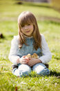 Young beautiful girl, playing with little newborn chick in the p Royalty Free Stock Photo