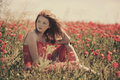 Young beautiful girl in poppy field Royalty Free Stock Photo