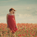 Young beautiful girl in poppy field