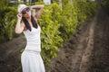 Young beautiful girl posing in fall vineyard Royalty Free Stock Photo