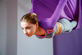 Young beautiful girl practicing aerial yoga in gym Royalty Free Stock Photo