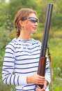 Young beautiful girl with a shotgun Royalty Free Stock Photo