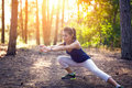 Young beautiful girl sports in the autumn forest at sunset Royalty Free Stock Photo