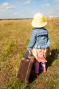 Lonely girl with suitcase. Back view Royalty Free Stock Photo