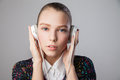 Young beautiful girl wearing headphones closeup of isolated over grey background Stock Image