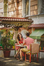 Young beautiful happy loving couple sitting at street open-air cafe looking at each other. Beginning of love story. Relationship l Royalty Free Stock Photo