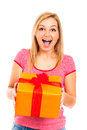 Young beautiful happy surprised woman with gift Royalty Free Stock Image