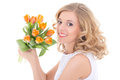 Young beautiful happy woman with orange tulips isolated on white Royalty Free Stock Image